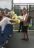 Two times Grand Slam champion Victoria Azarenka signing autographs after practice for US Open 2013 at Billie Jean King National Tennis Center — Stock Photo