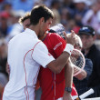 Постер, плакат: Professional tennis players Stanislas Wawrinka and Novak Djokovic after semifinal match at US Open 2013 at Billie Jean King National Tennis Center