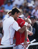 Professional tennis players Stanislas Wawrinka and Novak Djokovic after semifinal match at US Open 2013 at Billie Jean King National Tennis Center — Stock Photo