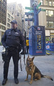 NYPD transit bureau K-9 police officer and K-9 German Shepherd providing security on Broadway during Super Bowl XLVIII week in Manhattan — Stock Photo