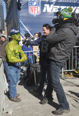 Unidentified Seattle Seahawks fan during interview on Broadway during Super Bowl XLVIII week in Manhattan — Stock Photo