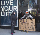 Unidentified man with sign asking for money to buy weed on Broadway during Super Bowl XLVIII week in Manhattan — Stock Photo
