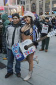 Alex, the Naked Cowgirl, entertains the crowd in Times Square during Super Bowl XLVIII week in Manhattan — Stock Photo