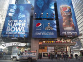 Pepsi Official Soft Drink of Super Bowl XLVIII billboard on Broadway during Super Bowl XLVIII week in Manhattan — Stock Photo
