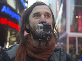 Unidentified man shooting video using Hero3 camera on Broadway — Stock Photo