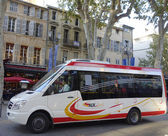 Aix en Bus minibus in medieval part of Aix en Provence, France — Stock Photo