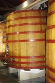 Wooden fermentation tanks at the vineyard — Stock Photo