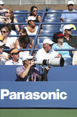 Professional photographer and spectators during US Open 2013 at Billie Jean King National Tennis Center — Stock Photo