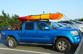 Toyota Tacoma SUV loaded with kayak and bicycles in Acadia National Park — Stock Photo