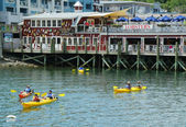Tourists riding sea kayaks in Bar Harbor, Maine — Stock Photo