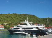 Mega yachts in Gustavia Harbor at St Barts — Stock Photo