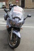 Sign on booted by the City of New York illegally parked motorcycle in Manhattan — Stok fotoğraf