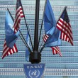 United Nations and United States Flags in the front of UN Headquarter in New York — Stock Photo #43406027