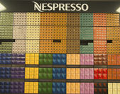 Variety of coffee capsules in Nespresso store — Stock Photo