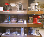 Variety of coffee machines in Nespresso store — Stock Photo