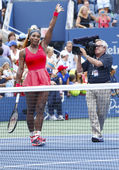 Grand Slam champion Serena Williams celebrates victory after fourth round match at US Open 2013 — Stock Photo