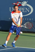 Professional tennis player Alexandr Dolgopolov from Ukraine during first round doubles match at US Open 2013 — Stock Photo