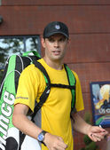 Grand Slam champions Bob Bryan signing autographs after match at US Open 2013 — Stock Photo