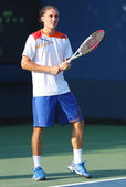 Professional tennis player Alexandr Dolgopolov from Ukraine during first round doubles match at US Open 2013 — Photo