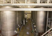 Stainless steel fermentation tanks at the vineyard — Stock Photo