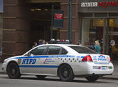 NYPD recruit car in midtown Manhattan — ストック写真