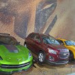 Постер, плакат: GM cars Chevrolet Camaro Corvette Stingray C7 concept and Chevrolet Sonic RS Rally Car from new movie Transformers Age of Extinction on display in New York