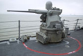 MK-38 25mm chain gun aboard the guided-missile destroyer USS McFaul during Fleet Week 2014 — Foto de Stock