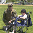 Unidentified US Navy from EOD team with unidentified child after mine countermeasures demonstration during Fleet Week 2014 — Stock Photo #46997915