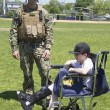 Unidentified US Navy from EOD team with unidentified child after mine countermeasures demonstration during Fleet Week 2014 — Stock Photo #47058263