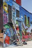 Street artist painting mural at Williamsburg in Brooklyn — Stock Photo