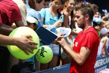 Professional tennis player Stanislas Wawrinka signing autographs after practice for US Open 2013