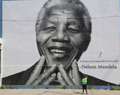 Unidentified child in the front of the Nelson Mandela mural in Williamsburg section in Brooklyn — Stock Photo