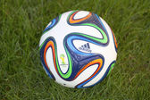 Brazuca soccer ball on grass — Stock Photo