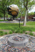 Eternal flame in the front of World Trade Center Sphere damaged at September 11 in Battery Park — Stock Photo
