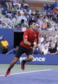 Six times Grand Slam champion Novak Djokovic during first round singles match against Ricardas Berankis at US Open 2013 — ストック写真