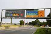 Signs at the entrance to John F. Kennedy International Airport in New York — Stock Photo