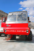 Massive Ice Explorer, specially designed for glacial travel, take tourists onto the surface of the Athabasca Glacier in the Columbia Icefields, Canada — Stock Photo