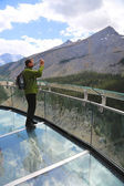 Tourist at the Glacier Skywalk in Jasper National Park — Stock Photo