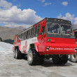 Massive Ice Explorers, specially designed for glacial travel, take tourists in the Columbia Icefields, Canada — Stock Photo #50618647