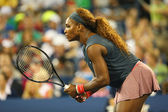 Sixteen times Grand Slam champion Serena Williams during first round doubles match with teammate Venus Williams at US Open 2013 — Stock Photo