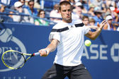Professional tennis player Mikhail Youzhny during fourth round match at US Open 2013 — Stock Photo