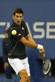 Profi-tennis spieler novak đoković im viertelfinale spiel bei uns öffnen 2013 gegen michail michailowitsch juschny — Stockfoto