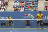 Grand Slam champions Mike and Bob Bryan during third round doubles match at US Open 2013 — Stok fotoğraf