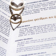 Wedding Rings and Marriage Certificate — Stock Photo