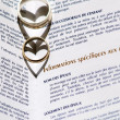 Stock Photo: Wedding Rings and Marriage Certificate
