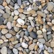 Smooth river stone background — Stock Photo #27039339