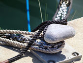 Mooring bollard with naval rope — Stock Photo