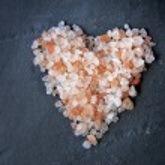 Himalayan salt on a black slice — Stock Photo #42039493