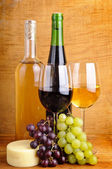 Still life with cheese and wine — Stock Photo