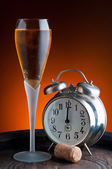 Champagne and clock — Stockfoto